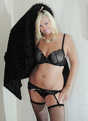 Platinum Blonde strips out of her black coat and bra.