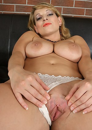 Busty blonde Ramona strips and plays with her tight box