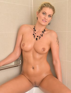 Busty blonde mommy gets naked for a naughty bath