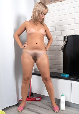 Jessy Fiery is cleaning the floors and is eager to masturbate today. So, she finds a spot by the TV, strips naked, and touches herself. She then starts touching her hairy pussy and rubs her 34A breasts.