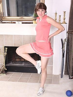 Flexible cutie Katrina Mathews shows her cheerleading skills in a sexy skirt