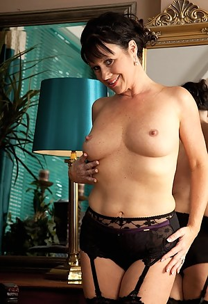 Stunning cougar Elise Summers wearing only black stockings.