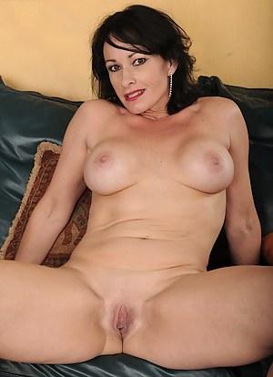Naughty mature cougar Braxton Kai exposes big fake tits.