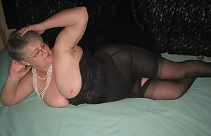 Black girdle and long line bra, silver gloves and sexy Girdlegoddess is ready to show off her stuff. Just waiting for a