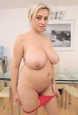44 year old busty Sindy Huga creams up her mammoth melons here