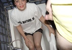 Mature slut getting pissed upon in the bathtub