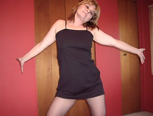 In my bedroom getting ready for a night out in my little sexy black dress, my sexy black nylon pantyhose that i slowly t