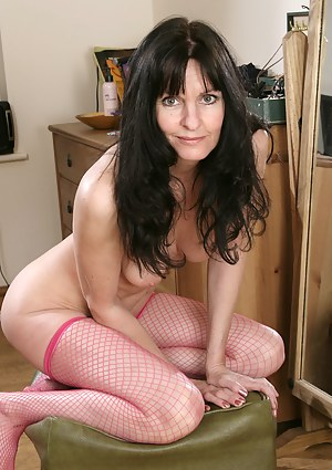 Spicey hot Scarlett D in pink fishnets shows off her shaved pussy