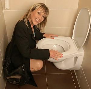 Horny mature slut fucking on a toilet
