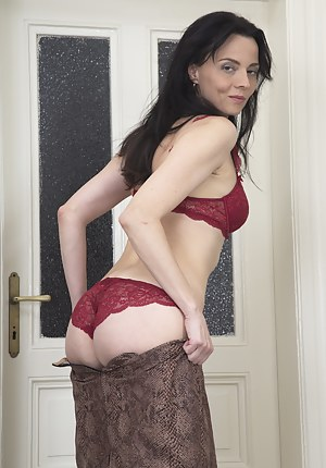 This naughty housewife enjoys herself at home