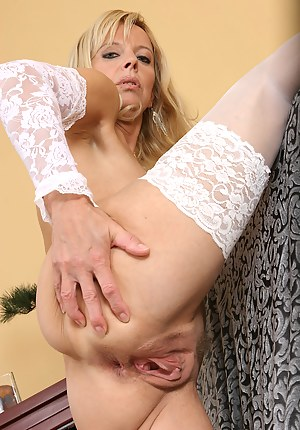 Blonde and mature Merilyn unwraps herself just for you in here