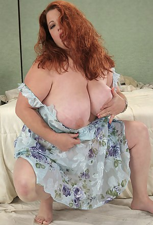 Huge tits on this red headed MILF spreading pussy on the bed