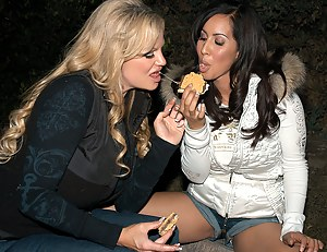 Isis Love and Kelly Madison share more than smores on this camping trip they suck and fuck out in the wild.