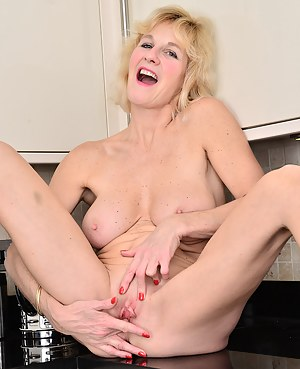 Busty blonde Molly Maracas slips out of her jeans and flashes in the kitchen