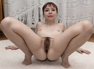 Trixie is a sexy wild sport and stretches while showing off her body. She strips naked, and lays nude on her carpet. She has a thick hairy pussy, petite breasts, and is quite fetching naked and hairy.