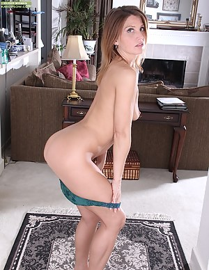 Mature redhead Sky Rodgers spreads pussy wide open.