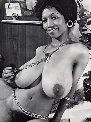 Black seventies hottie showing her massive natural boobs