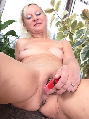 Naughty blonde housewife playing alone