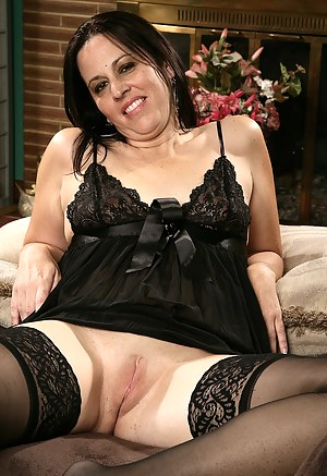 Kim's beautiful 34 year old body looks amazing in her black lingerie
