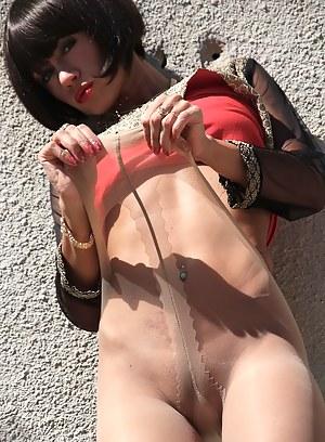 Leggy MILF sweetie posing outdoor in thinnest tan pantyhose