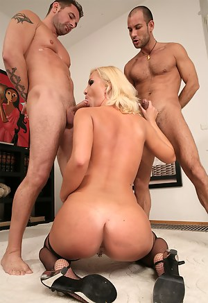 Enter this big room and see lovely blonde in black stockings fucking with two strong guys. She is getting her wide holes tortured so hard.