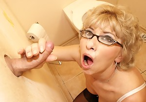 This horny mature slut loves to suck on the crapper