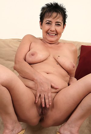57 year old housewife Yvette strips off her cloths and sucks on her boobs