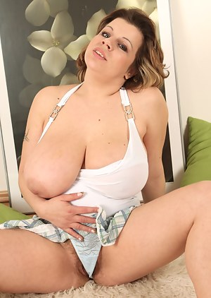 If you like huge natural titties bouncing around while seeing a big hairy pussy being rubbed then you will love Vanda! She has a bush ripe for a good banging.