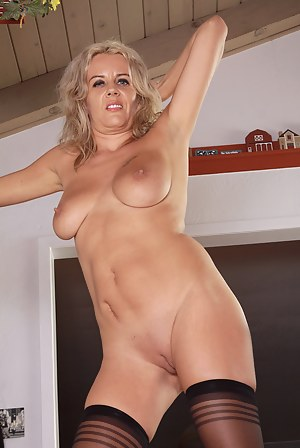 37 year old Olga D from AllOver30 spreads her long mature legs here
