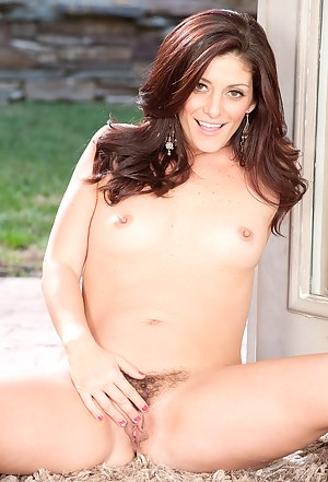 Horny 33 year old Alicia Silver spreading her hairy pussy in the yard