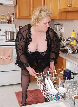 I am busy doing my kitchen chores when I feel a hard cock poking at my butt... That's what I get for wearing sexy sheer
