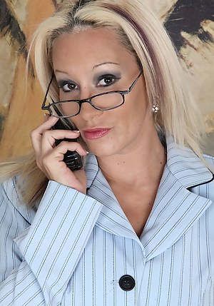 Sexy slutty office worker Brea strips naked on her desk.