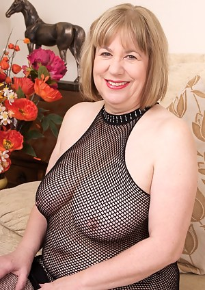 Hi Guys Here I am in my lounge wearing my Black Fishnet dress and my fishnet holdups and feeling very hot and Horny so i