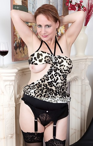 Tiffany T. sips her glass of wine in front of the fireplace and slides her cheetah dress all the way up. Her hairy pussy pops out of her sexy panties. And then she plays with her hairy pussy.