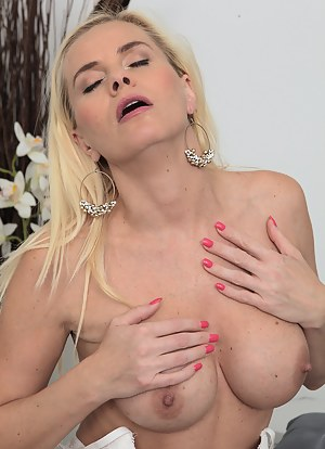 Stunning stacked blonde Lilly Peterson strips out of her sexy white lingerie