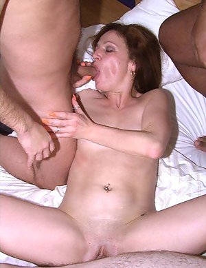 This horny housewife loves two cocks at once