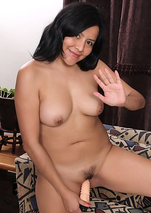 Exotic honey Cici Jones slips out of her nightie and onto a thick vibrator