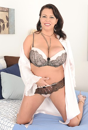 Massive boobed Angelica Sin rocking out in some sexy lingerie