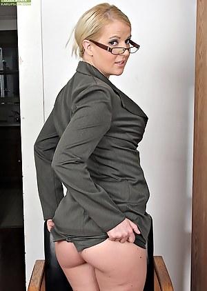 Busty secretary Anita Blue strips butt ass naked.
