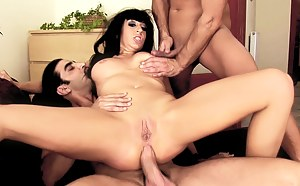 Two men are fucking one slutty woman really hard. They are drilling her juicy holes in different moves and feeding her with warm cum.