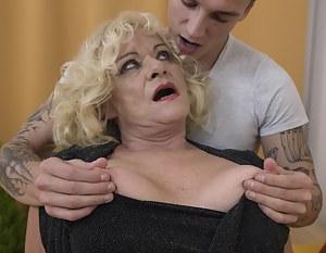 Horny mature slut doing her toy boy