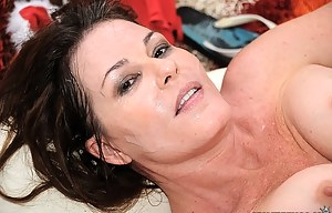 Busty woman is enjoying passionate sex with her partner on Christmas. They are fucking on the floor and finishing with wild cumshot.