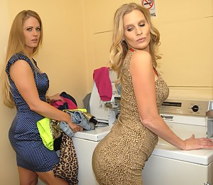 Slutty lady wearing sexy dress is cleaning kitchen and enjoying passionate fun with another lesbian. The ladies are satisfying each other wildly.