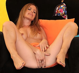 Older babe Carly Bell caught fingerbanging herself.