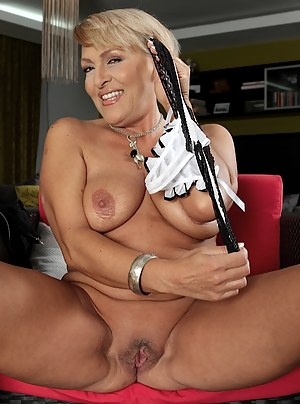 Busty wife Andrea spreads her older pussy wide.
