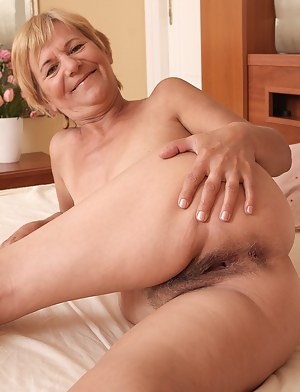 Lili shows off her furry 56 year old pussy and ass for the camera