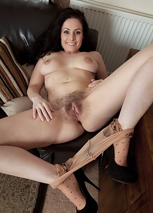 Sophia Delane loves playing with her hairy pussy. She lifts up her dress showing you her hairy mound through her see through stockings. Taking off her clothes she spreads her pussy lips to the world.
