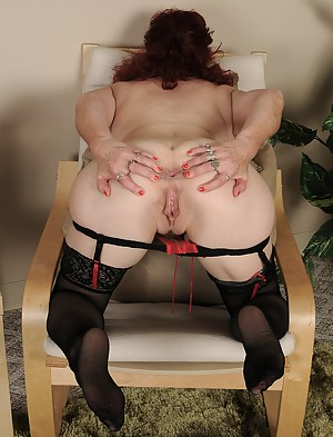 Popular mature redhead Surely in knee high stockings spreads wide