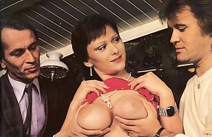 Busty short haired 80s MILF gets fucked by two men in a bar